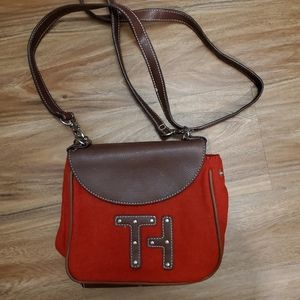 Tommy Hilfiger crossbody red and brown purse.